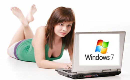 Woman lying on floor and working with computer